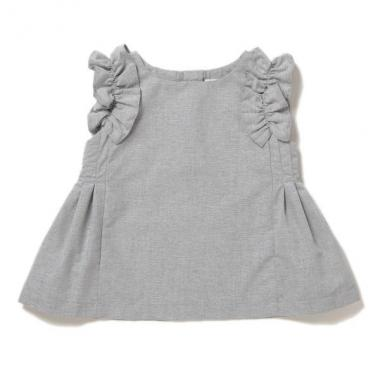 Shoulder ruffle with a sleeveless blouse